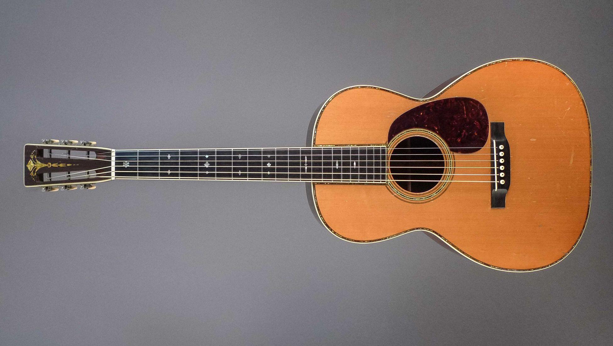 guitare a 5 mains