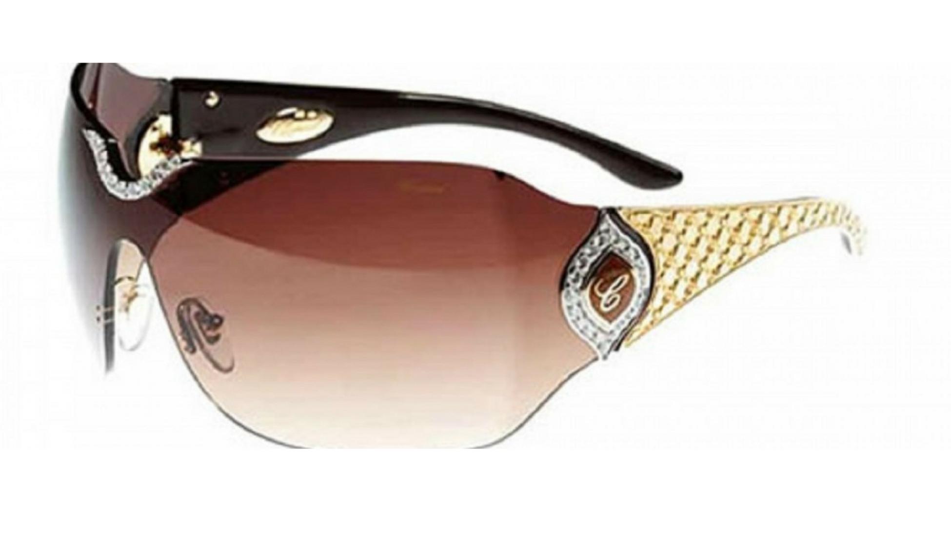 Bågarna på glasen är gjorda av guldprickar vilket ger dessa designer  solglasögon ett unikt utseende. da10098320891